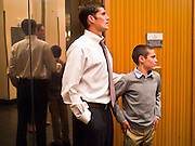 28 FEBRUARY 2012 - PHOENIX, AZ:    MATT ROMNEY, son of Republican presidential candidate Mitt Romney, and his son, wait to get on an elevator in a Phoenix, AZ, hotel. Several hundred Romney supporters crowded into a ballroom in a Phoenix hotel to watch primary results from Michigan and Arizona. Romney won the night, scoring a tight win in the Michigan Republican Presidential primary and a comfortable win in the Arizona Republican Presidential primary.     PHOTO BY JACK KURTZ