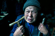 SHENGZHOU, CHINA -  china out - finland out<br /> <br /> A man cries out for his mental patient grandson at Gulai Town <br />  in Shengzhou, Zhejiang province of China. He Zili, 11, has suffered from psychosis for ten years. He fell out of bed when he was one year old. He began to attack villagers and damage property belonging to other people at the age of five. At first, his father He Chuyu tethered him to house with ropes, but he often bitted the rope off and ran away. He Chuyu had to tethered his son with a 2m long iron chain. He Chuyu and his son\'s pictures were posted on the Internet several days ago, a netizen saw that He Chuyu led his son with the iron chain and begged for money at a coach station, and took some photos. <br /> ©Exclusivepix