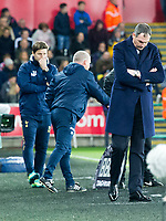 Football - 2016 / 2017 Premier League - Swansea City vs. Tottenham Hotspur<br /> <br /> Swansea City manager Paul Clement looks down & Tottenham Hotspurs manager Mauricio Pochettino, in background, looks thoughtful after Spurs score the 2nd goal , at The Liberty Stadium.<br /> <br /> COLORSPORT/WINSTON BYNORTH