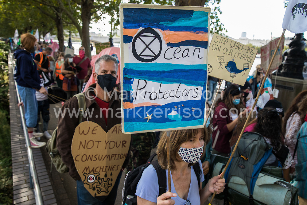 Climate activists from the Ocean Rebellion and Extinction Rebellion pass along the South Bank during a colourful Marine Extinction March on 6 September 2020 in London, United Kingdom. The activists, who are attending a series of September Rebellion protests around the UK, are demanding environmental protections for the oceans and calling for an end to global governmental inaction to save the seas.