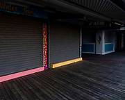 OCEAN CITY, MD - APRIL 26: Storefronts and restaurants sit shuttered along the boardwalk on April 26, 2020 in Ocean City, Maryland. The coronavirus pandemic shut down the city just before Easter Sunday which usually marks the beginning of the tourist season. Many hotel, restaurant, and tourism industry workers rely on the seasonal business during the warm months to provide most of their yearly income. (Photo by Samuel Corum/Getty Images)