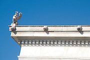 Exterior of the National Library of Greece, part of the architectural trilogy designed by Danish architect Theopil Hansen, Athens, Greece. Decorative Griffin