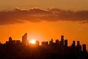 The skyline of Midtown Manhattan at sunset, featuring the Citicorp Building, New York City.