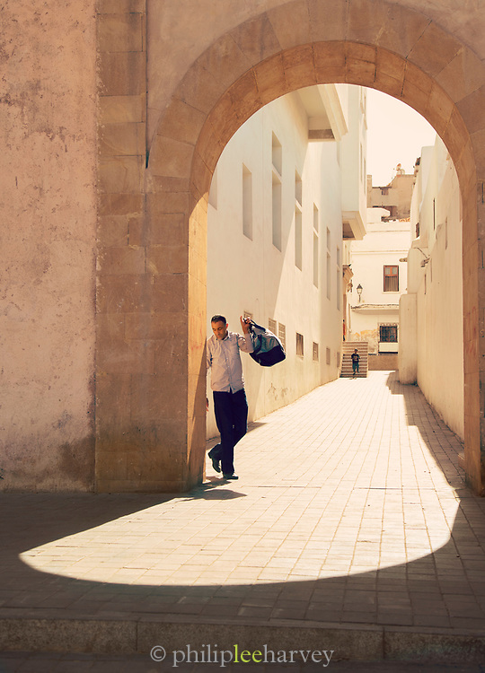 People walking in streets of medina on bright sunny day, Casablanca, Morocco