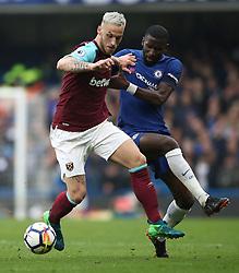 West Ham United's Marko Arnautovic (left) and Chelsea's Antonio Rudiger battle for the ball