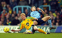 Photo: Scott Heavey.<br />Coventry v Norwich. Nationwide Division One. 14/02/2004.<br />Gary Holt slides in on Craig Pead