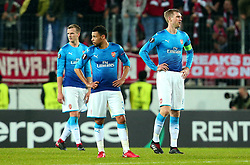 Per Mertesacker, Francis Coquelin and Rob Holding of Arsenal cut dejected figures after conceding a goal - Mandatory by-line: Robbie Stephenson/JMP - 23/11/2017 - FOOTBALL - RheinEnergieSTADION - Cologne,  - Cologne v Arsenal - UEFA Europa League Group H