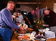 Chef Steve Lacroix serving salmon to Tom Dowd, Winterlake Lodge seafood dinner, Alaska.
