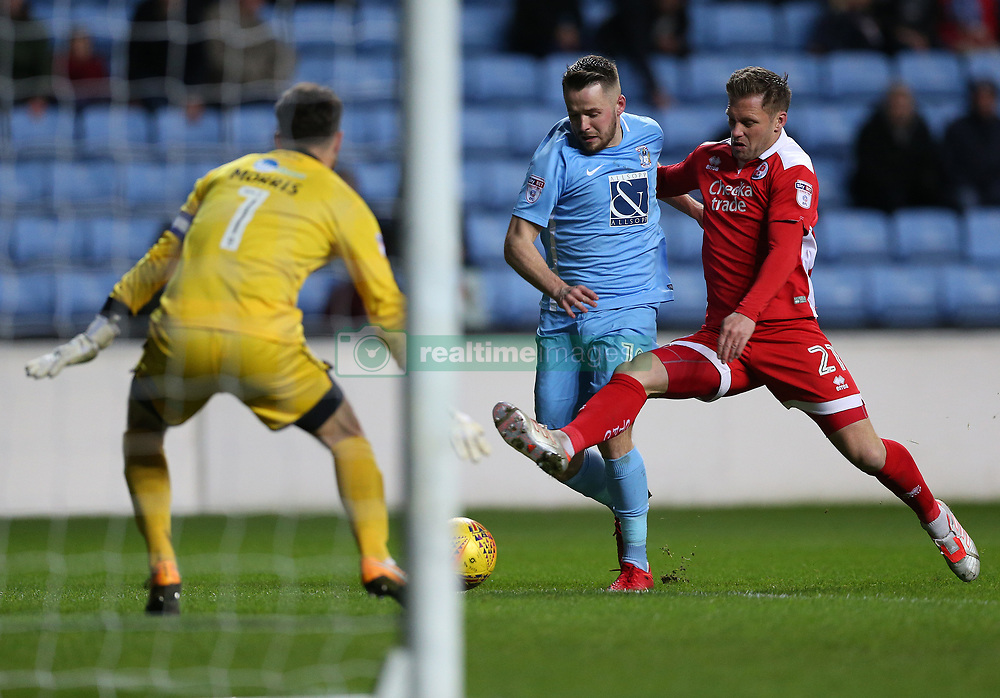 Coventry City's goal scorer Marc McNulty and Crawley Town's Dannie Bulman