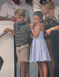 Prince George and Princess Charlotte look through a window at the prize giving after the King's Cup regatta at Cowes on the Isle of Wight.