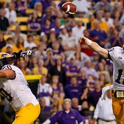 October 16, 2010; Baton Rouge, LA, USA; McNeese State Cowboys quarterback Cody Stroud (18) throws a touchdown pass against the LSU Tigers during the first half at Tiger Stadium.  Mandatory Credit: Derick E. Hingle