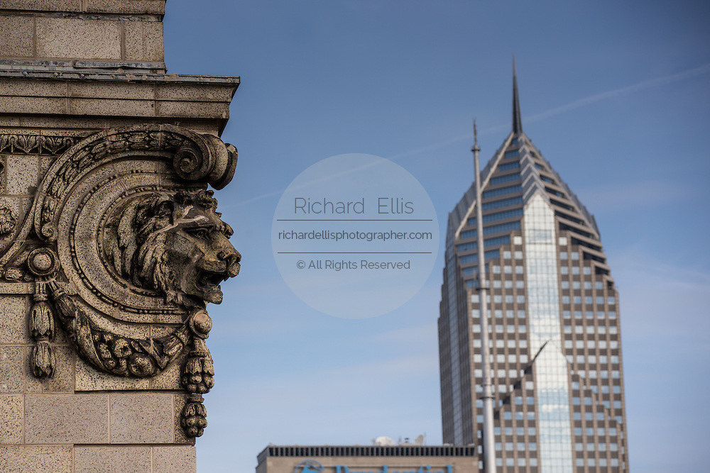 Lions head on a building with Two Prudential Plaza tower seen from the Cliff Dwellers Club in Chicago USA