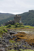 Low tide at Eilean Donan castle on the 1st September 2016 in Dornie in Scotland in the United Kingdom. Eilean Donan castle is situated on Eilean Donan, a small tidal island where three lochs meet, Loch Duich, Loch Long and Loch Alsh, in the western Highlands of Scotland.