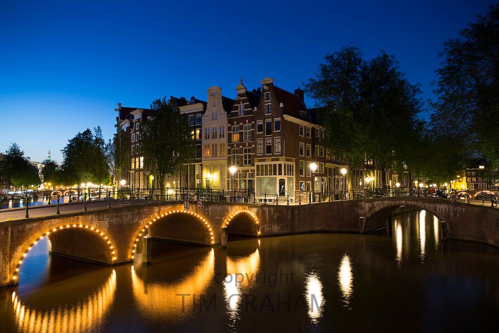Illuminated bridges at Kaisersgracht and Leidsegracht, canal ring area, Jordaan district, Amsterdam
