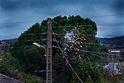 electrical short with sparks on a above the ground residential electrical wire distribution network France