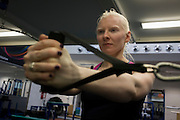 Partially-sighted skiing paralympian from the Sochi Olympics, Kelly Gallagher trains in the gym at the Sports Institute, University of Ulster, Northern Ireland, UK.