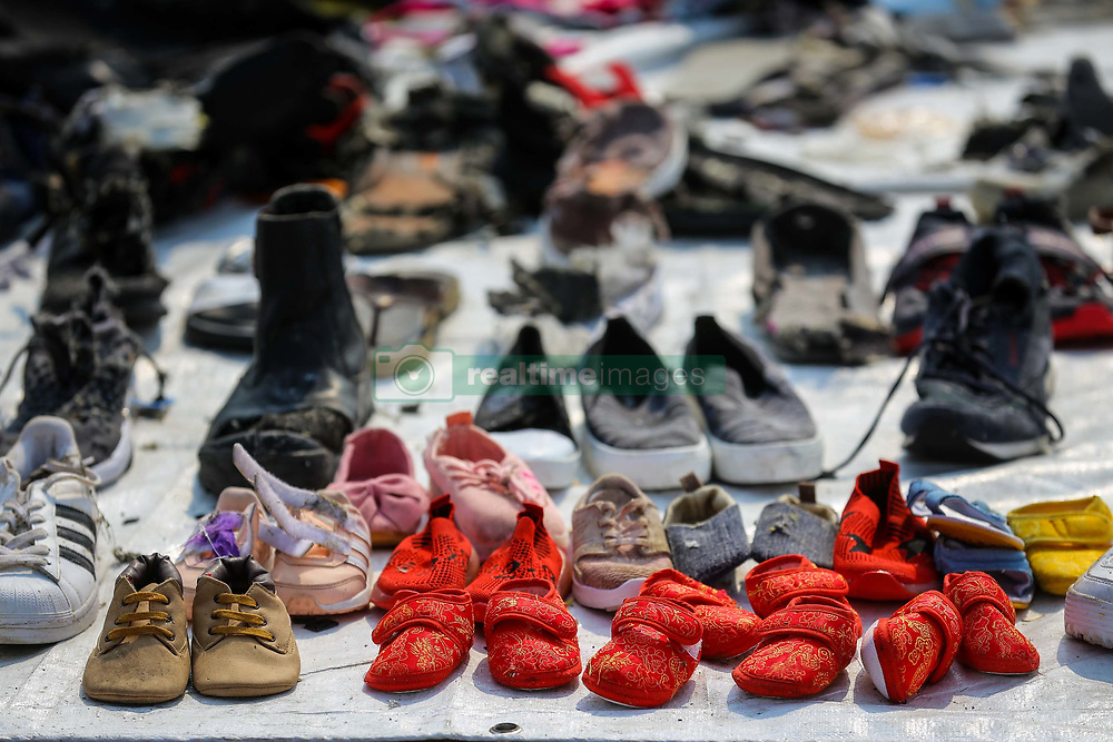 November 1, 2018 - Tanjung Priok, Jakarta, Indonesia - Shoes and personal items recovered from Lion Air flight JT 610 by Search and Rescue personnel at the Tanjung Priok port at Tanjung Priok Harbour, Jakarta. Rescuers have recovered human remains and personal items in the wreckage, with all 189 passengers and crew feared dead, the plane crashed into the sea just minutes after taking off from Indonesia's capital. (Credit Image: © Andrew Lotulung/NurPhoto via ZUMA Press)
