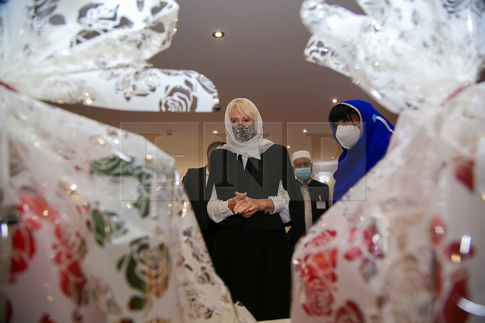 © Licensed to London News Pictures. 07/04/2021. London, UK. Camilla, Duchess of Cornwall, wearing a protective face covering and headscarf is shown the food hampers during a visit to the London Islamic Cultural Society and Mosque (also known as Wightman Road Mosque) in Haringey, north London. The Mosque was formed by a small group of Guyanese Muslims and now supports over 30 different nationalities and community in Haringey and surrounding boroughs. Photo credit: Dinendra Haria/LNP