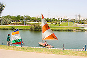 Israel, Tel Aviv, Hayarkon Park sail boat on the Yarkon river