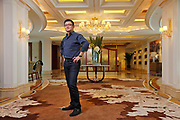 Ni Lin, Chairman of the Suzhou Gold Mantis Construction Decoration Co., LTD, poses for photographs at the company's office in Suzhou, Jiangsu Province, China on 19 July 2012. Gold Mantis is one of the largest interior decorations company in China, with clients include the National Stadium (Bird Nest),  the Great Hall of the People, The National Performance Art Center, etc.
