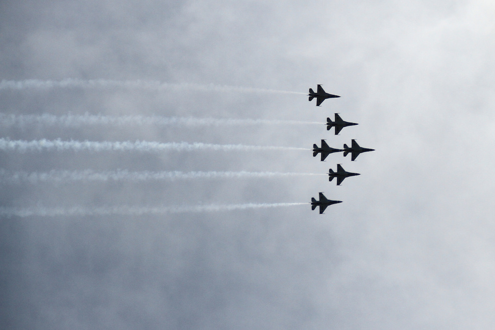 The Thunderbirds perform maneuvers at an Airshow at McGuire Air Force Base in New Jersey.<br /> Copyright John O'Boyle<br /> john@johnoboyle.com