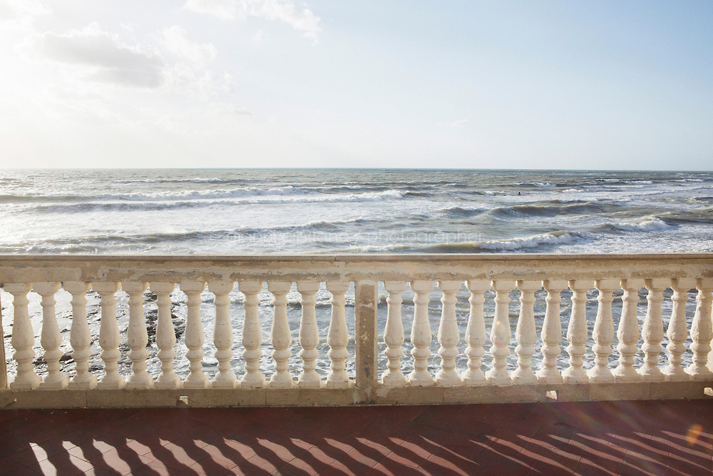 """SCICLI, ITALY - 23 OCTOBER 2014: View from the balcony of the location used as the house of the Commissario Montalbano, where scenes of the TV series """"Il Commissario Montalbano"""" have been shot, in Punta Secca, Italy, on October 23rd 2014."""