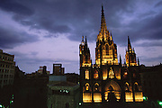 Night shot of the façade of the Gothic Cathedral (built 13th to 15th Century) in Barcelona, Spain, Seen from the Hotel de Colon.