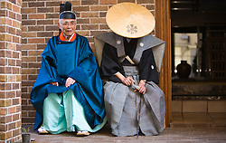 Asia, Japan, Gifu prefecture, Takayama (also known as Hida-Takayama), Shinto priests in traditional robes and hats during Sanno Festival of Hie Jinja Shrine, held annually in April.