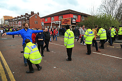 20th April 2017 - UEFA Europa League - Quarter Final - Manchester United v Anderlecht - Security personnel check and search fans outside the ground - Photo: Simon Stacpoole / Offside.