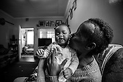 Jacqui Gathumbi, 38 years old, collapsed while she was 7 months pregnant. She became distant and unaware of her surroundings, was diagnosed with a brain tumor. One month before it was surgically removed in Oct 2013 she gave birth to her daughter Angel. It took the removal of the tumor at Kijabe Hospital for Jacqui to regain her awareness and even know she had given birth. After the operation she underwent 27 sessions of radiotherapy to kill the remaining 1% of the tumor.  The Faraja Cancer Support Trust, a charitable trust founded in 2010 with the mission to improve the quality of life for cancer patients and their families by providing information, emotional and practical support, counselling, and complimentary therapies to cancer patients and their carers. <br /> This image is part of an on-going personal project looking at the rise of cancer in Africa, that it is not just a stereo-typical western disease but because of diet, stress and environmental changes it is now very much now  becoming a part of African life.<br /> Photographer Georgina Goodwin. Copyright 2014 Georgina Goodwin. All Rights Reserved.