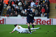 Tottenham's Gareth Bale is tackled by Swansea's Chico Flores. . Barclays Premier League, Swansea city v Tottenham Hotspur at the Liberty Stadium in Swansea, South Wales on Saturday 30th March 2013. pic by Andrew Orchard, Andrew Orchard sports photography,