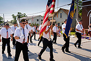 03 JULY 2021 - NORWALK, IOWA: The honor guard from American Legion Post 562 marches through town during the 4th of July parade in Norwalk, Iowa. Last year's parade was cancelled because of the COVID-19 pandemic. Norwalk is an agricultural community south of Des Moines. In recent years, Norwalk has become a suburb of Des Moines.       PHOTO BY JACK KURTZ