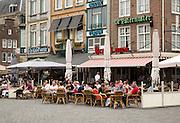 People sitting outside cafes in summer s-Hertogenbosch, Den Bosch, North Brabant province, Netherlands
