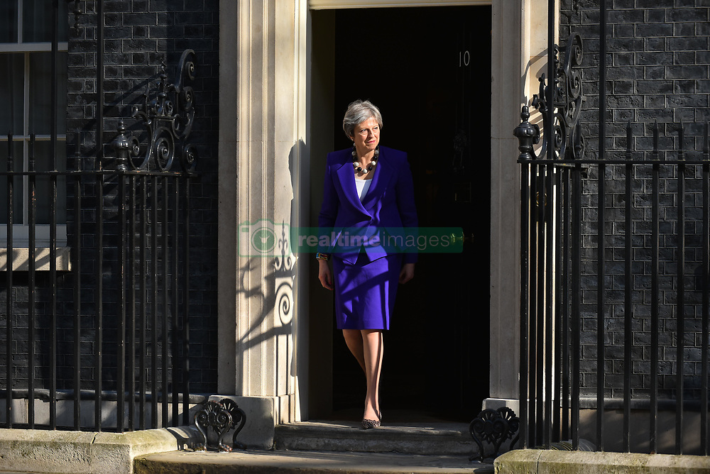 April 18, 2018 - London, England, United Kingdom - British Prime Minister Theresa May leaves Number 10 Downing Street to greet the Prime Minister of India Narendra Modi ahead of a bilateral meeting on April 18, 2018 in London, England. Mrs May holds bilateral talks with a number of Commonwealth leaders today as the UK this week hosts heads of state and government from the Commonwealth nations. (Credit Image: © Alberto Pezzali/NurPhoto via ZUMA Press)