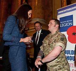 © Licensed to London News Pictures. 26/04/2012.  The Duchess of Cambridge chats to Royal Engineer Clive Smith (26) a double amputee at a Royal British Legion reception in the Goldsmiths Hall today in Central London.  Sapper Clive Smith was injured by an IED in Helmand in 2010.   He is currently going through a rehabilitation program at the Royal British Legions Battle Back facility... Photo credit: Alison Baskerville/LNP