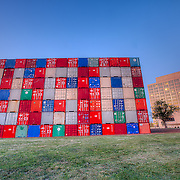 """Temporary conceptual art display at Penn Valley Park in Kansas City, Missouri of shipping containers that say """"USA"""" and IOU"""" on public parkland right across the street from the Kansas City Federal Reserve."""