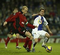 Photo: Aidan Ellis.<br /> Blackburn Rovers v Bayer Leverkusen. UEFA Cup, 2nd Leg. 22/02/2007.<br /> Rovers Morten Gamst Pedersen (R) challenges Bayer's Carsten Ramelow