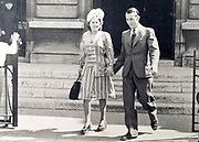 couple leaving church France ca 1960s