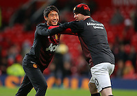 Manchester United's Shinji Kagawa (L) warms up ahead of the Barclays Premier League match at Old Trafford, Manchester. PRESS ASSOCIATION Photo. Picture date: Tuesday January 28, 2014. See PA story SOCCER Man Utd. Photo credit should read: Dave Thompson/PA Wire. RESTRICTIONS: Editorial use only. Maximum 45 images during a match. No video emulation or promotion as 'live'. No use in games, competitions, merchandise, betting or single club/player services. No use with unofficial audio, video, data, fixtures or club/league logos.