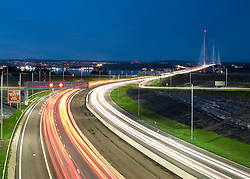 Night view of traffic on approach roads to new Queensferry Crossing Bridge in West Lothian , Scotland, united Kingdom