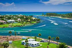 busy weekend boat traffic at Jupiter Inlet, junction of Intercoastal Waterway and Loxahatchee River, Jupiter, Florida, USA, Atlantic Ocean