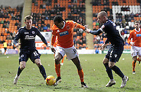 Blackpool's Nathan Delfouneso holds off Millwall's Alan Dunne and Martyn Woolford<br /> <br /> Photographer Mick Walker/CameraSport<br /> <br /> Football - The Football League Sky Bet Championship - Blackpool v Millwall - Saturday 10th January 2015 - Bloomfield Road - Blackpool <br /> <br /> © CameraSport - 43 Linden Ave. Countesthorpe. Leicester. England. LE8 5PG - Tel: +44 (0) 116 277 4147 - admin@camerasport.com - www.camerasport.com