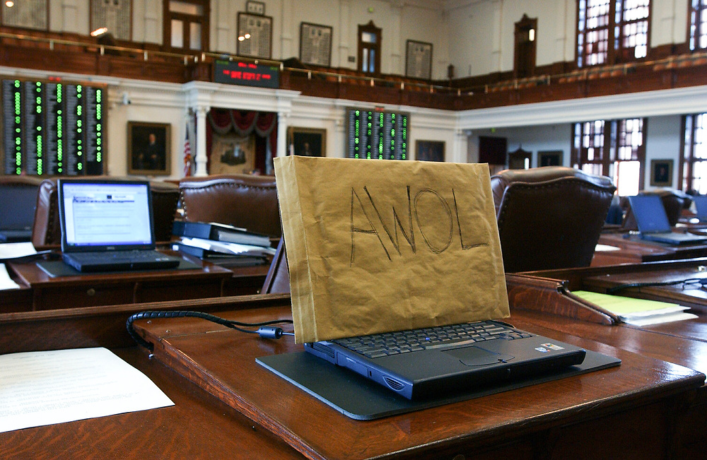 Images from 2003's Democratic walkout in the Texas House from May 12-13, 2003 during the 78th session of the Texas Legislature include a covered Dell laptop.