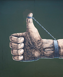 Fist and handcuffs mural on newly repainted Berlin Wall at East Side Gallery Berlin April 2009