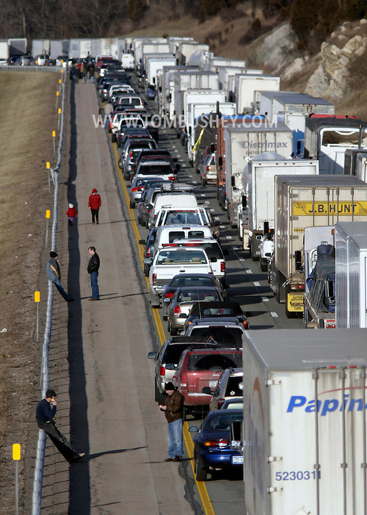 Motorists stand on the shoulder of the northbound lanes of the New York State Thruway after a fatal accident stopped traffic south of the Harriman exit on Feb. 7, 2006. The photograph was taken from the Arden Road overpass in the Town of Tuxedo..