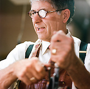 """Bob Tedrow, 59, of Birmingham, Alabama is one of six concertina makers in the United States, and approximately 20 in the entire world. Tedrow moved to Birmingham from the midwest in 1988 to open Homewood Musical Instrument Company, and has been making concertinas there in the store shop since the mid-1990's. """"It's an incredible work of art,"""" Tedrow said. """"There's just no other instrument that combines charming workmanship and early 19th century craftsmanship, all with the portability of a six pack of beer."""""""