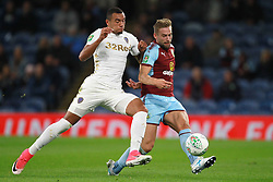 Leeds United's Jay-Roy Grot (left) and Burnley's Charlie Taylor battle for the ball during the Carabao Cup, third round match at Turf Moor, Burnley.