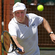 Camille Dezarnaulds, Australia, in action in the 75 Mens singles during the 2009 ITF Super-Seniors World Team and Individual Championships at Perth, Western Australia, between 2-15th November, 2009.