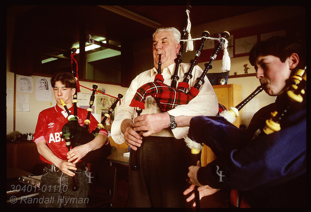 Jim Anderson, Blackwatcher who played at JFK's funeral, teaches teenage boys bagpipes; Buckhaven Scotland