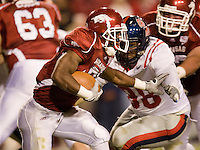 FAYETTEVILLE, AR - OCTOBER 25:   Michael Smith #21 of the Arkansas Razorbacks runs with the ball against the Ole Miss Rebels at Donald W. Reynolds Stadium on October 25, 2008 in Fayetteville, Arkansas.  The Rebels defeated the Razorbacks 23 to 21.  (Photo by Wesley Hitt/Getty Images) *** Local Caption *** Michael SmithUniversity of Arkansas Razorback Men's and Women's athletes action photos during the 2008-2009 season in Fayetteville, Arkansas....©Wesley Hitt.All Rights Reserved.501-258-0920.